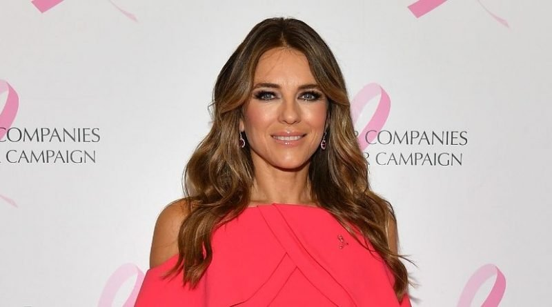 Elizabeth Hurley Wows In A Plunging Cover-Up As She Poses On The Bed