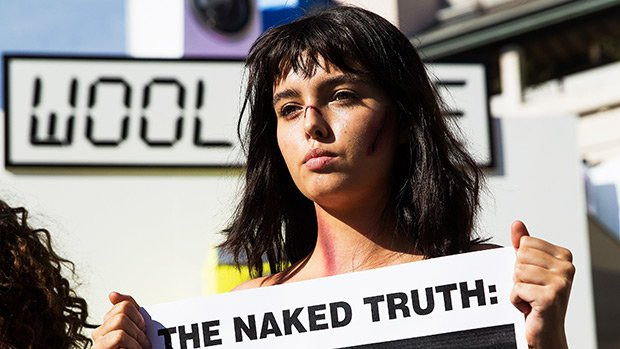 Topless women protest Canada Gooses use of coyote fur in